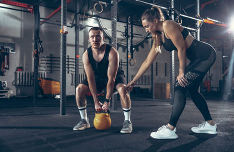 athletic-man-woman-with-dumbbells(1)