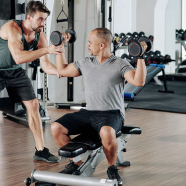 exercising-with-fitness-coach-MYHFCKE