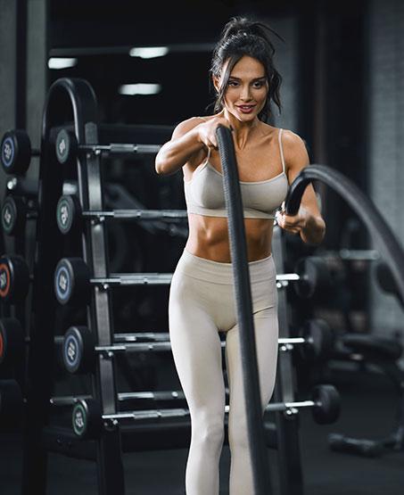 brunette-woman-doing-battle-rope-training