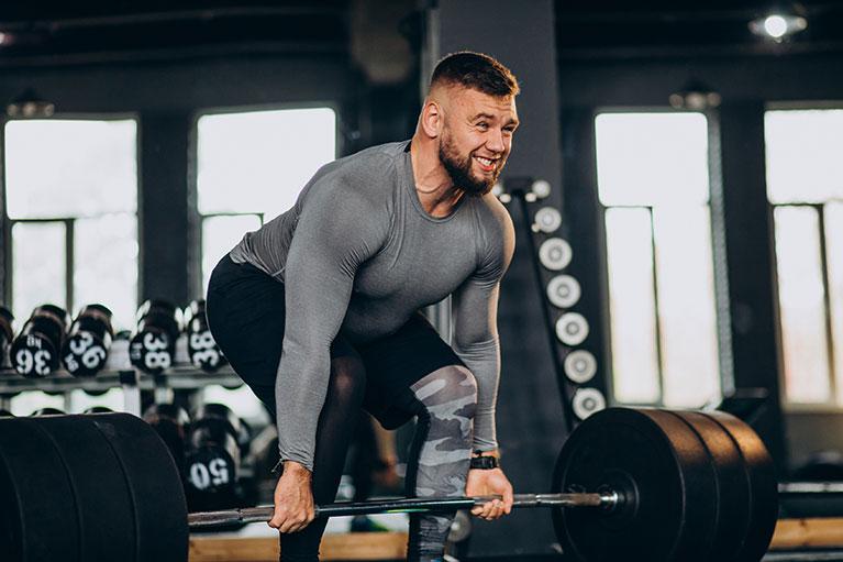 strong-man-exercising-gym(1)